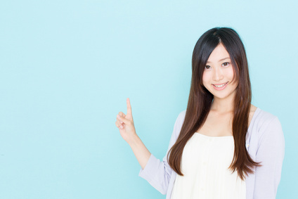 young asian woman showing on blue background